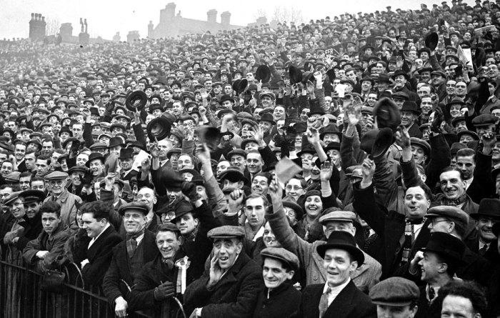 "Highbury in 1938. Stewards shouting ""Siddown!"" not pictured"